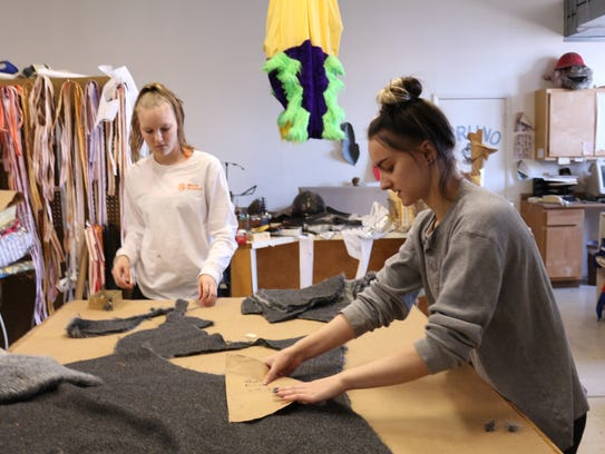 Kelli Fortman, a sophomore at Mercy, works with Amber