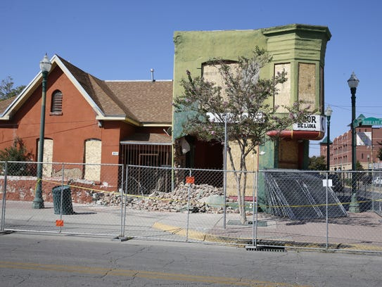 Fencing was placed around some of the buildings in the so-called Duranguito neighborhood after demolition crews started punch holes in them last year.