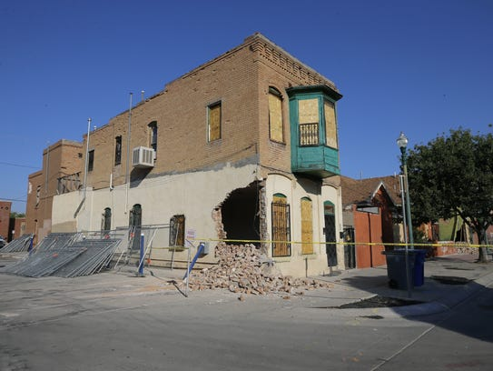 A look at the damage done to one of the buildings in the so-called Duranguito neighborhood after demolition crews started punch holes in them last year.