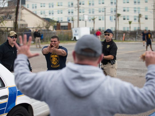 A police cadet yells commands during a drill after being sprayed in the face with pepper spray Friday, Dec. 5, 2017 at Corpus Christi Police Academy. The 2019 Corpus Christi police academy is currently budgeted for next year, and the department will add eight new officers to its ranks.