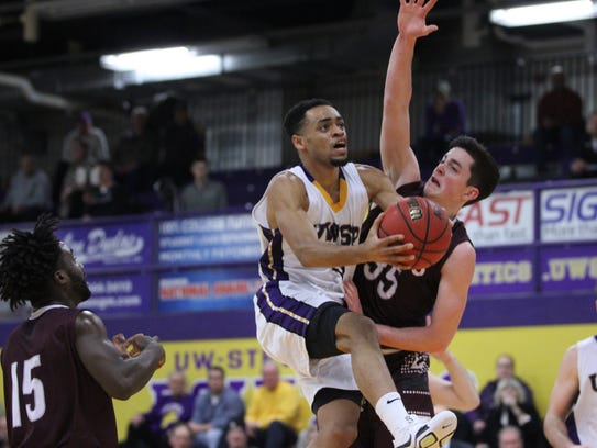 UW-Stevens Point's Koko Songolo scores on a drive to