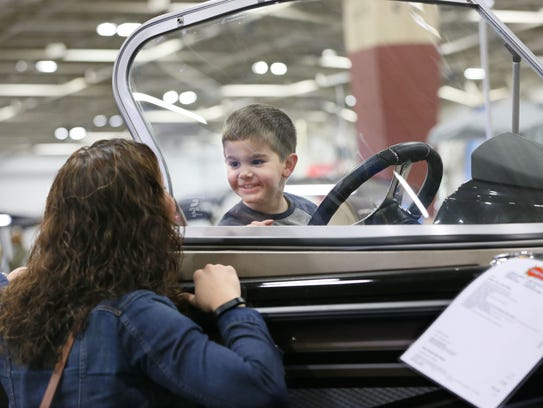 Dylan Montemurro, 3, of Kenosha is in the driver's