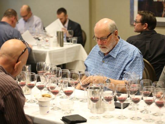 Joe Anderson, Benovia Winery, looks over the notes