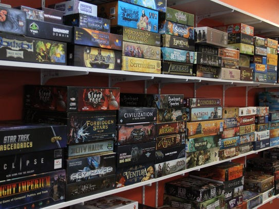 The wall of games at Ticket to Play Board Game Cafe is stocked with plenty of options.