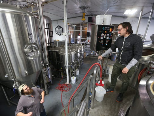 Proof Brewing Company brewer David Kant-Rauch, left,