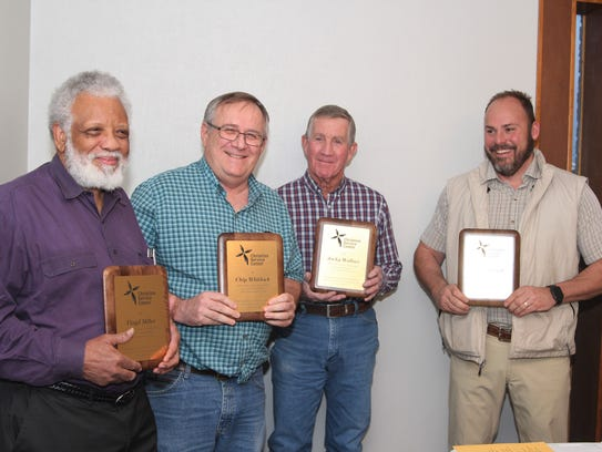 Four retiring board members of the Christian Service
