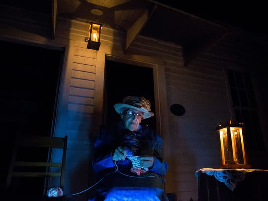 Performer Joan Westcott, as Sister Vesta, knits as