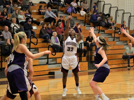 Owen senior Kristyl Keeter, who scored a game-winning layup against Madison on Feb. 5, puts up a shot in a home win against Mitchell on Senior Night on Feb. 6.