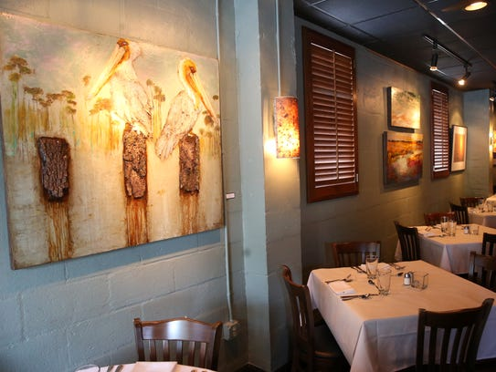 Artwork on the walls at Cypress Restaurant in Tallahassee.