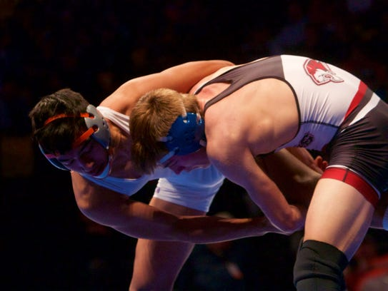 Hurricane's Caleb Armstrong wrestles in the finals
