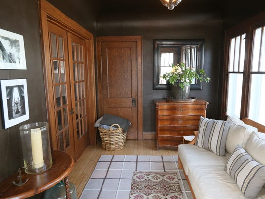 This sunroom area at the entrance to the home is a