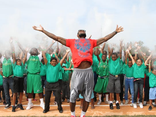 "LeBron James joins 200 youth in a spontaneous ""chalk"