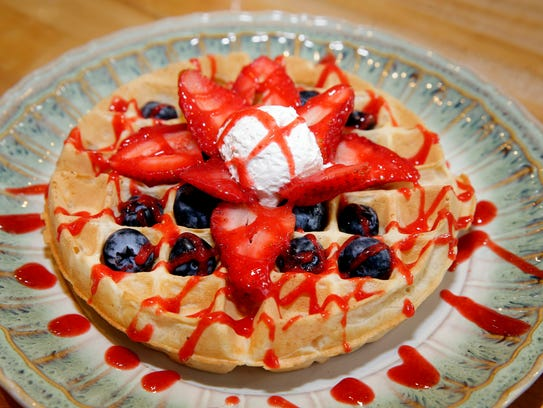 A berry Belgian waffle, made with chickpea liquid in