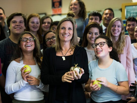 Heather Thornton, a high school science teacher, poses