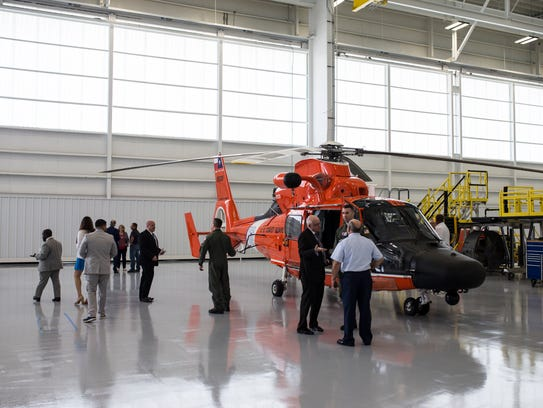 People tour the new Coast Guard hanger after the Valent