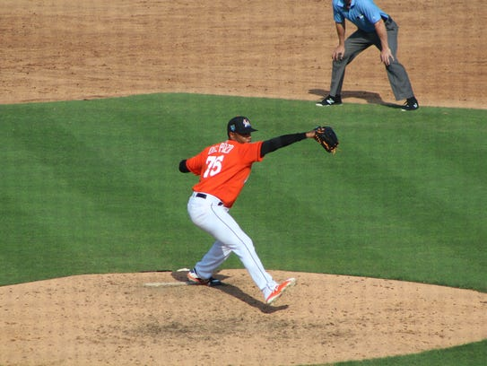 Miguel Del Pozo pitches during his ninth inning save