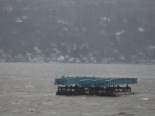Some of the barges are carrying what appear to be construction