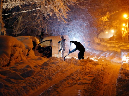 Residents on Mills Street in Morristown dig out their