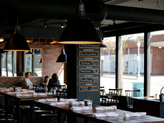The dining room at Revolution Rotisserie & Bar in the