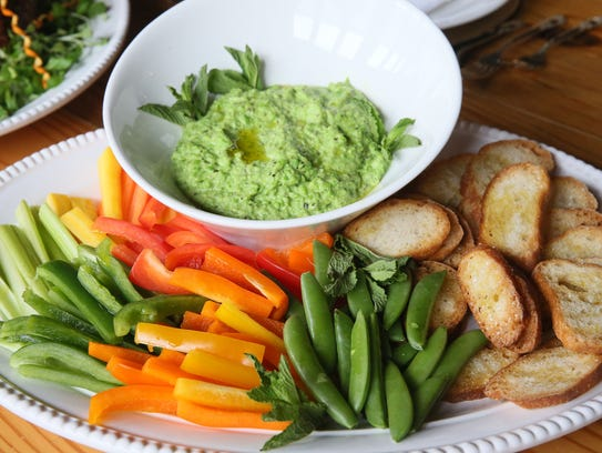 An easy pea and garlic dip is served with crudités