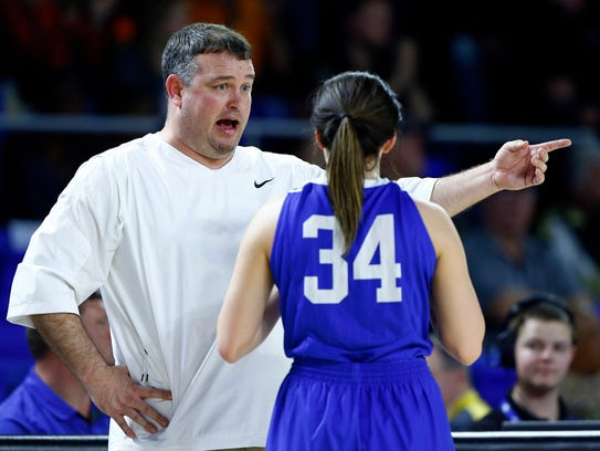 Summertown coach Craig McGill talks to Hailey Jones