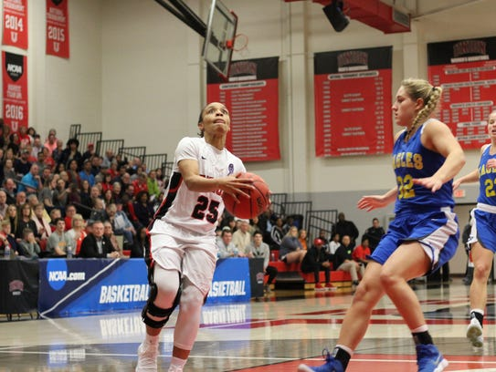 Chelsey Shumpert goes up for a layup during a game.