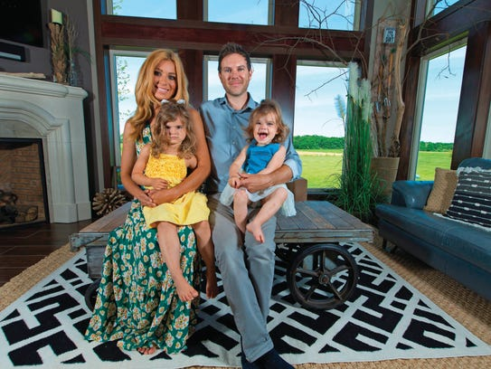 Casey and Jason Lawrence are the parents of Lana, left,