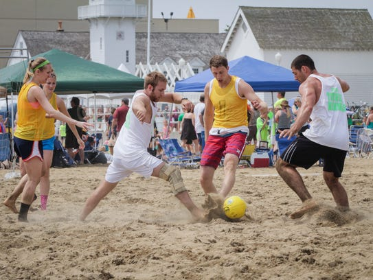 Sand soccer teams indulge in some friendly competition