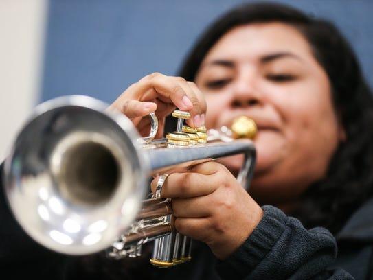 Belen Hernandez practices mariachi song on her trumpet