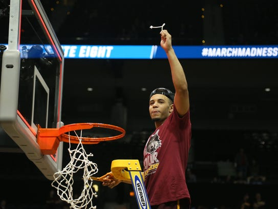 Loyola Ramblers guard Marques Townes (5) cuts the net