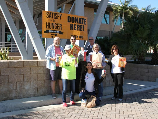 Volunteers gather to accept donations for Satisfy the