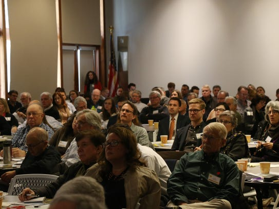 A crowd filled the multipurpose room at the FDR Library's
