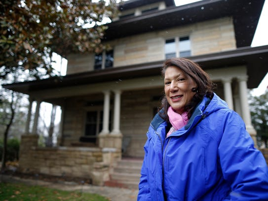 Jan-Michele Lemon Kearney grew up in this house on the corner of Rockdale and Wilson avenues in Avondale. Her father, Dr. Luther Lemon, refused to leave the neighborhood, keeping his home and family medical practice in place while other families fled.