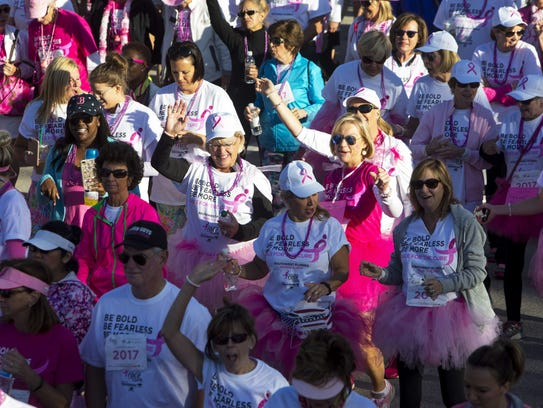 Women cheer and dance as they start the 1 mile walk