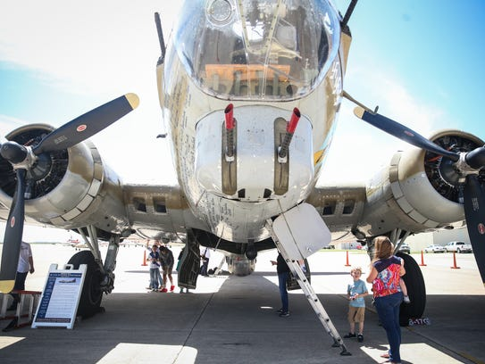Visitors walk around the B-17 Flying Fortress during