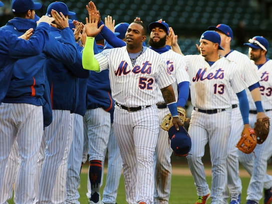 The New York Mets  react after defeating the Philadelphia