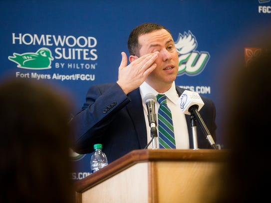 New FGCU men's basketball coach Michael Fly got emotional as he addressed his players during Thursday's press conference in Alico Arena.