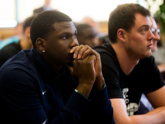 Although sometimes starting FGCU sometimes starting sophomore forward RaySean Scott is one of just four players new Eagles coach Michael Fly did not recruit, Fly is working very hard to keep him in Dunk City. Here Scott listens to Fly during Thursday's press conference in Alico Arena.