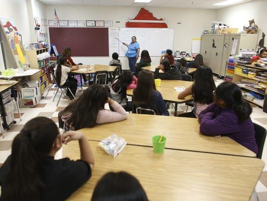 Language culture specialist Annette Rave conducts class