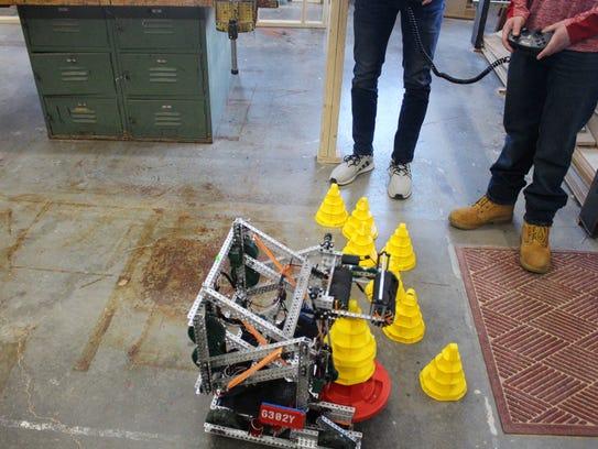 Mitchell Reasoner and Jaylin Tyler control the robot