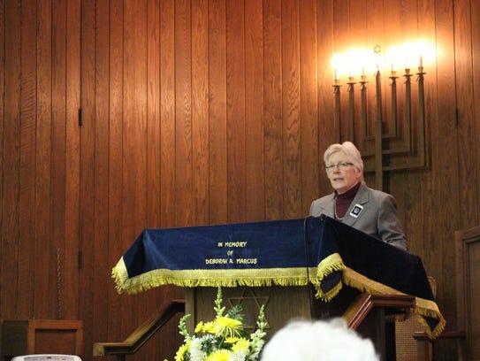 Morah Nancy Shimer speaks during the Holocaust Remembrance
