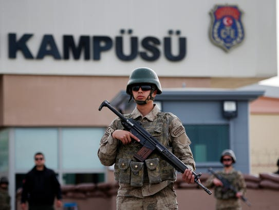 Members of Turkish forces guard the entrance to the prison complex in Aliaga, Izmir province, western Turkey, where jailed U.S. pastor Andrew Craig Brunson was held and appeared on trial in a court inside the complex.