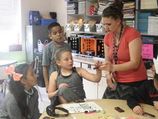 Haley Finch works with her third grade class for a