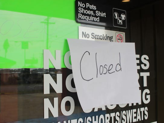 Closed signs were posted on the door of the Pitt Grill