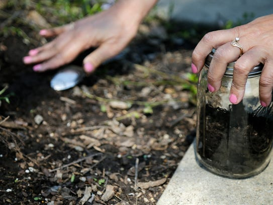 Chris Corbin collects soil from Oxford Memorial Park,