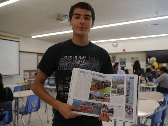 Elias Pimentel, editor in chief for the yearbook, showcases