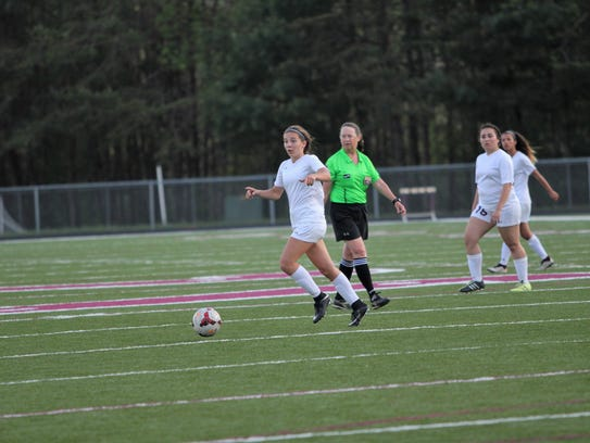 Sophomore Camryn Bolick directs teammates into position as she sets up an offensive attack against Mitchell in a 6-0 home victory for Owen.