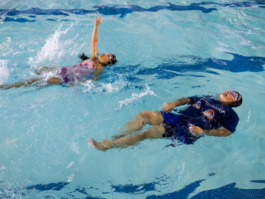 Kids work with swim instructors on Thursday, May 3,