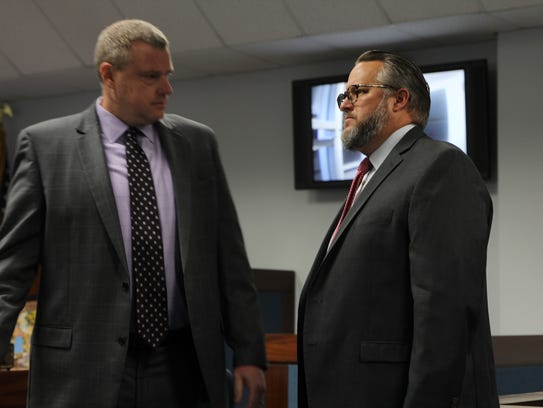 Assistant State Attorney Jon Fuchs, left, and defense attorney Ethan Way speak prior to first appearance for Denise Williams. Way represents Williams, who is charged with the murder of her slain husband Mike Williams in 2000.