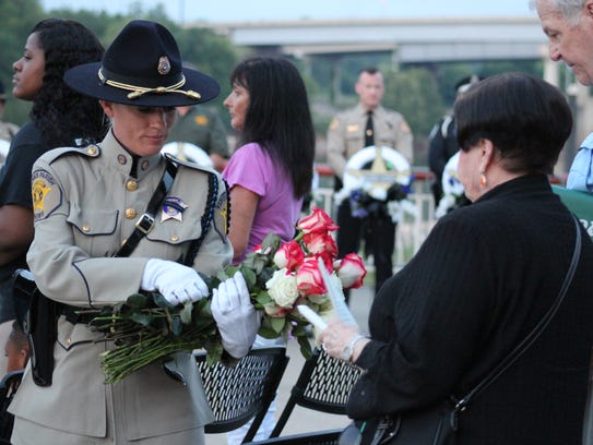 A Rapides Parish Sheriff's deputy hands roses to family